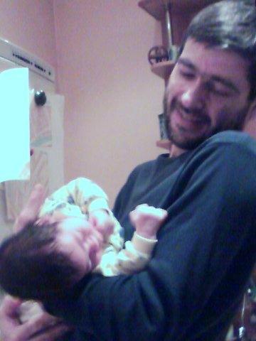 Александр Васильев с ребенком