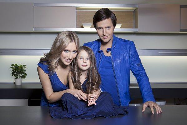 На фото: Витас с женой и дочкой