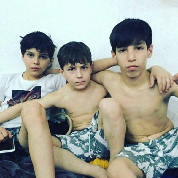 Младшие братья Зубайры Тухугова